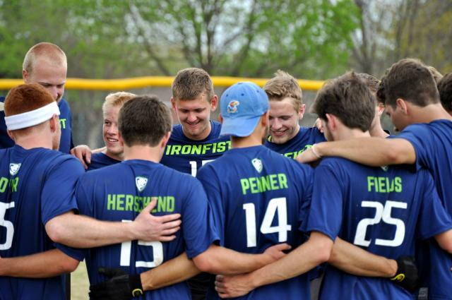Ultimate Frisbee, Ironfist, huddles after every game to debrief and pray. The Frisbee team is 14-0 before regionals.