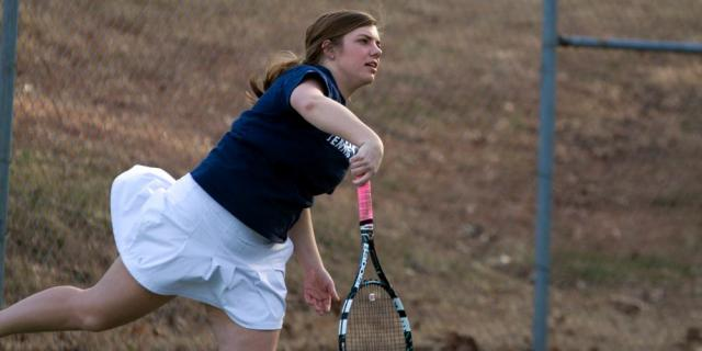 Claire Holden, freshman, sends the tennis ball to her opponent in a competition match as she stands at No. 6. JBU women's tennis team is now (3-3).