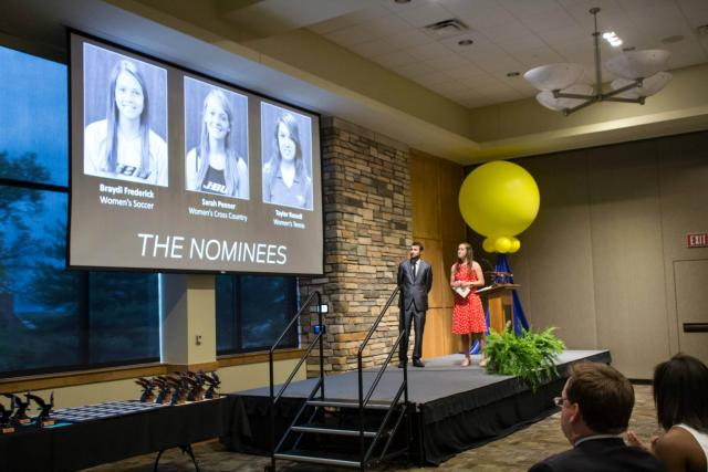 Coaches Kathleen Paulsen and Scott Marksberry announce the nominees for women's soccer at the Athletic Banquet last year. The Athletic Banquet celebrates the hard work and dedication of JBU athletes over the year.