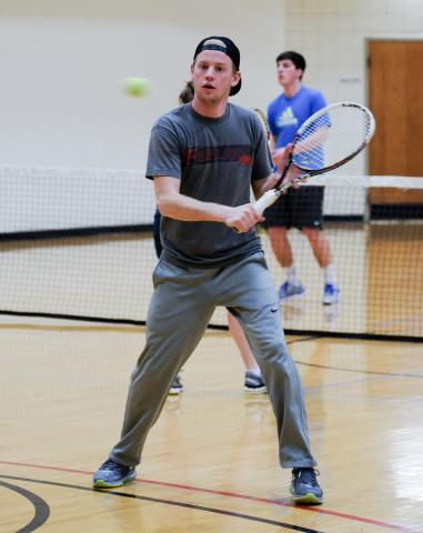 Luke Pascoe sharpens his hand and eye coordination as he practices his volleying skills. JBU's tennis team practices for two hours five days a week for two hours during which they work on drills and serves.