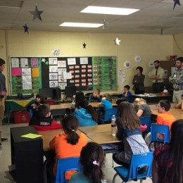 Caleb Taylor teaches a third grade class about Science, Technology, Engineering and Math activities at Southside Elementary with company of Margo Turner and other John Brown volunteers.