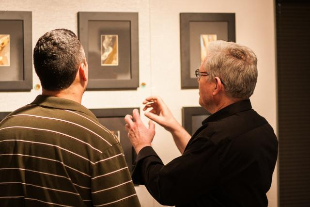 Joel Armstrong discusses his work with peers at at the opening night of his work in Art Windgate East on March 5.
