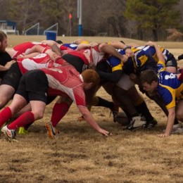 "JBU rugby team scrums against the University of Arkansas team as they give their best efforts to win. JBU Rugby's motto is ""Christ Over All,"" as they continue to show the ""Head, Heart and Hand"" of JBU on and off the field."