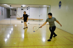 Students Jessica Jansma and Gustavo Zavala play racquetball in the Walton Lifetime Health  Complex.