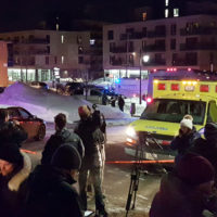 An ambulance is parked at the scene of a fatal shooting at the Quebec Islamic Cultural Centre in Quebec City, Canada January 29, 2017. REUTERS/Mathieu Belanger - RTSXZES