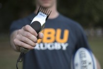 Men's rugby club cuts hair tradition
