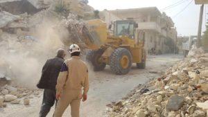 Courtesy of ASAID Emergency responders clear rubble in Maaret Nouman, Idleb, in November 2014.